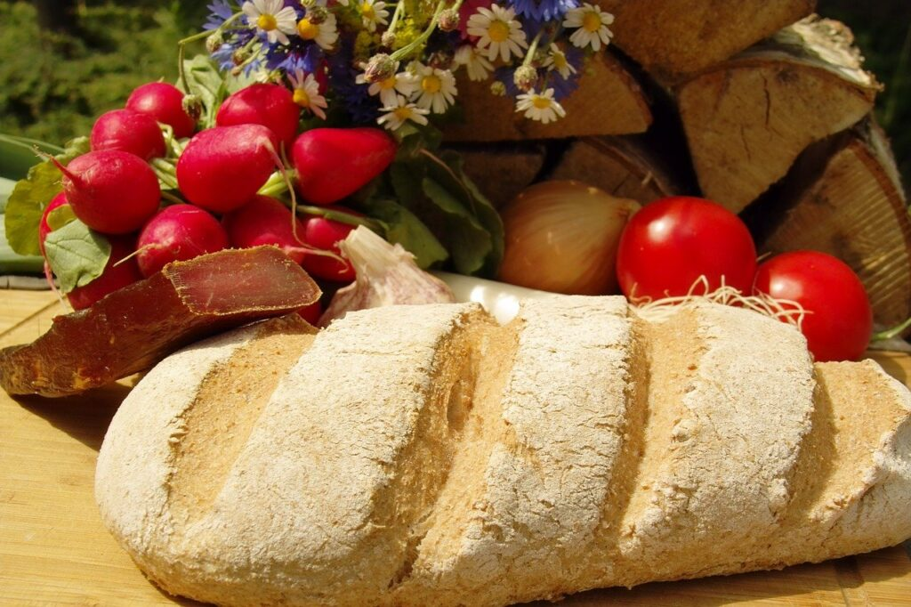 sourdough bread with flowers and produce